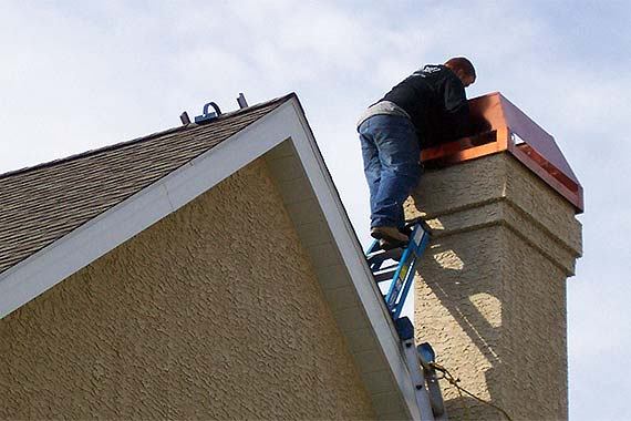 man-working-on-chimney-cap-chasetoppers_cb09c0ebf52236df4bc1637799a6ed42